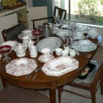 Two sets of china, crystal, dining room table and chairs
