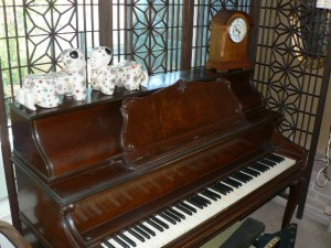Acrosonic piano with carved legs and matching bench