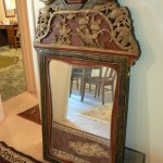 Chinese mirror, black lacquer with red and gilt paint