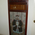 One of two Chinese carved and hand painted panels