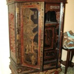 Chinese black lacquer wardrobe, hand painted and carved