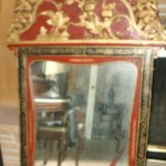 Chinese black lacquer mirror with red and gilt painting