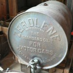 Antique motor oil barrel with spigot and advertising