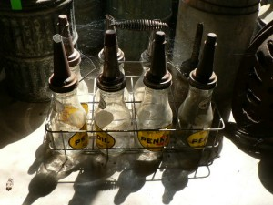 Antique motor oil bottles and carrying rack