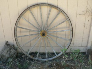 Lots of antique spoked wheels