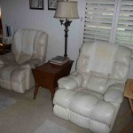 cream leather recliners, maple end table, torchier lamp