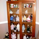 dolls and display cabinet