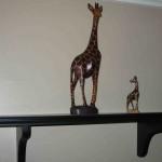 pair carved giraffes