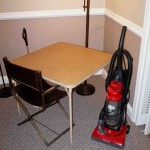 vacuum card table f;loor lamp and chair