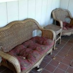 wicker loveseat chair and end table